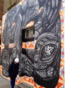 muslim boy in front of wall